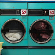 Stock Photo: Row of Clothes Dryers - Laundromat