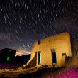 Stock Photo: Fort Churchill Nevadwith star trails