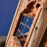 Broken windows and crumbling brick wall at Nevada Ghost town. — Stock Photo #24076711