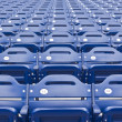 Stock Photo: Empty blue stadium seating in rows.