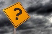 Story skies with question mark road sign — Stock Photo