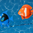 Stock Photo: Two Toy Fish Flying