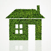 House icon made of green tree on white background — Stock Photo