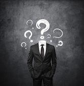 Hombre sin cabeza con signos de interrogación del dibujo — Foto de Stock