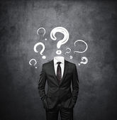 Man standing without head with drawing question marks — Stock Photo