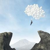 Businessman flying on ballons — Stock Photo