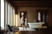 Mooi meisje in badkamer met kaarsen — Stockfoto
