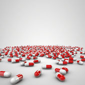 Red pills isolated on a white background — Stock Photo