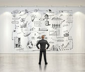 Man and strategy on white wall — Stock Photo