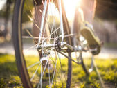 Closeup of ciclyst legs on a bicycle — Stock Photo