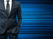 Man in the suit on blue background — Stock Photo