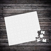 Jigsaw puzzle on wood table — Stock Photo