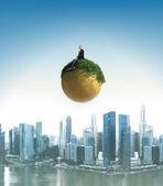 Businessman planet — Stock Photo