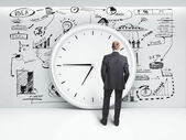Man looking at clock — Stock Photo