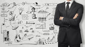 Man and business strategy on the wall — Stock Photo