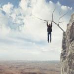 Business man climbs a mountain — Stock Photo