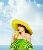Woman drinking juice on a tropical beach — Foto Stock