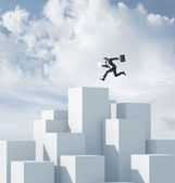 Businessman on a highest cube — Stock Photo