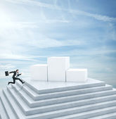 Businessman running to highest cube — Stock Photo
