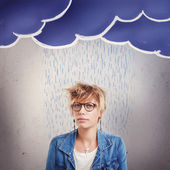 Upset young woman in the rain — Stock Photo