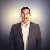Excited man with luminous lightbulbs — Stock Photo