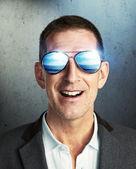 Mature man wearing sunglasses — Stockfoto