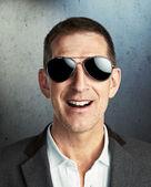 Mature man wearing sunglasses — Stock Photo