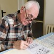 The old cartoonist at work — Stock Photo