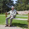Senior dozing on bench — Stock Photo
