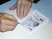 The old cartoonist hands drawing — Stock Photo