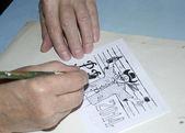 The old cartoonist hands drawing — ストック写真