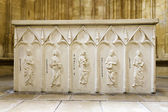 The stone altar table with reliefs of the four Evangelists — Stock Photo