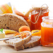 Apricot jam and bread — Stock Photo #24424035