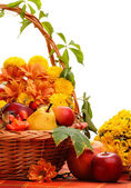 Autumnal decor with fruits and leaves — Stock Photo
