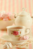 Tea and meringue cookies — Stock Photo