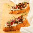 Mushrooms bruschetta — Stock Photo