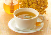Medicinal herbal tea in white cup — Stock Photo
