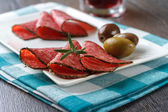 Slices of salami sausage — Stockfoto