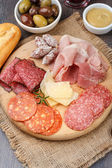Appetizer with different type of salami — Stock Photo