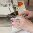Hand sewing on a machine — Stock Photo