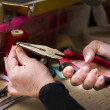Woman working with pliers — Stock Photo #26720917