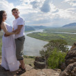 Young Couple hugging in mountains — Stock fotografie