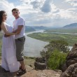 Young Couple hugging in mountains — Stockfoto