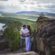 Couple  kissing in mountains — Foto de Stock