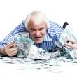 Man lying in the money — Stock Photo
