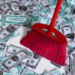 Stock Photo: Broom in money