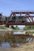 Freight train on the bridge — Stock Photo