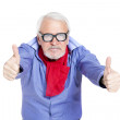 Older businessman giving thumbs up — Stock Photo