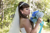 Young bride with a bouquet — Stock Photo
