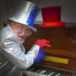 Magician playing the piano — Stock Photo